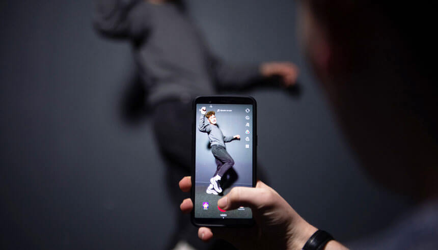 A person poses for the picture using Chinese short-form video sharing app TikTok