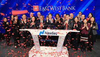 East West Bank executives and board members celebrated the company's 20th year of going public in February 2019 by ringing the Nasdaq opening bell In New York