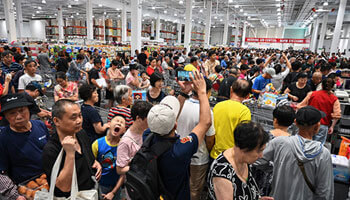 People visiting the first Costco outlet in China