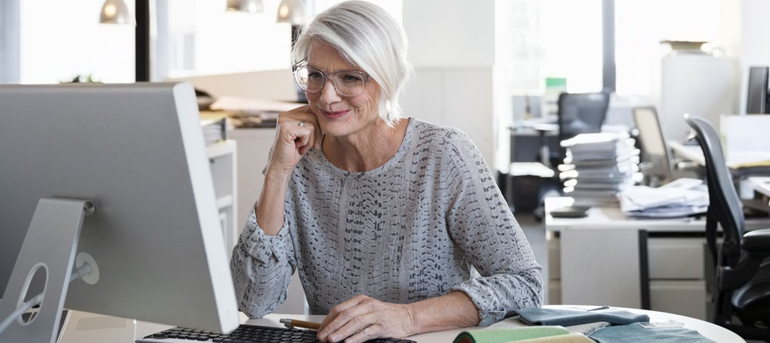 Senior female looking at computer for senior savings account