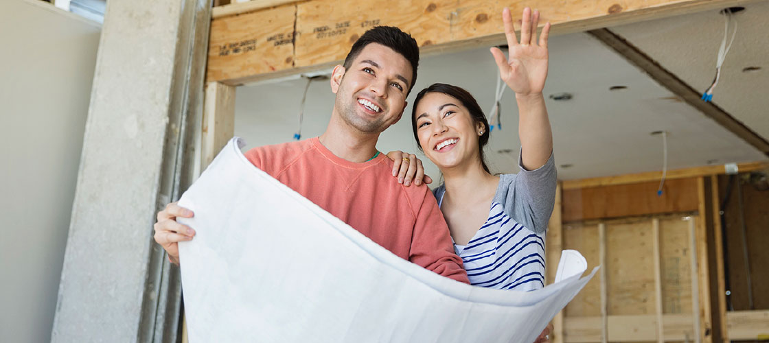 Smiling optimistic couple renovating their home