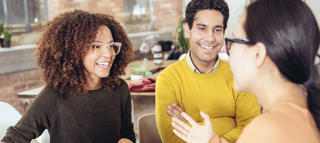 Smiling couple speaking with a home equity line of credit agent