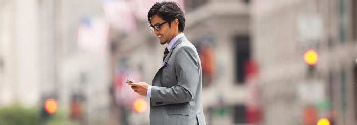 Business man looking at his mobile phone for business checking