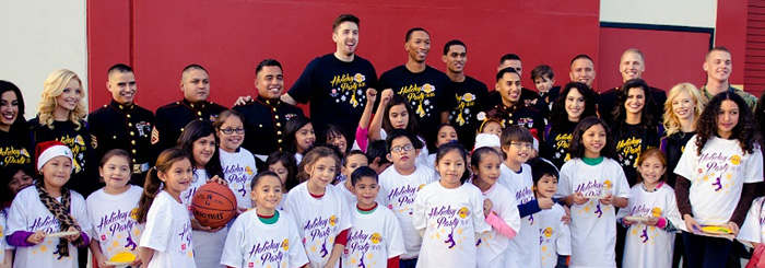 Bank employees and Los Angeles Lakers treat local children to a meal and fun activities
