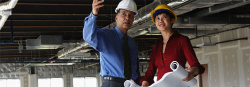 Commercial real estate banker and construction manager on commercial property site