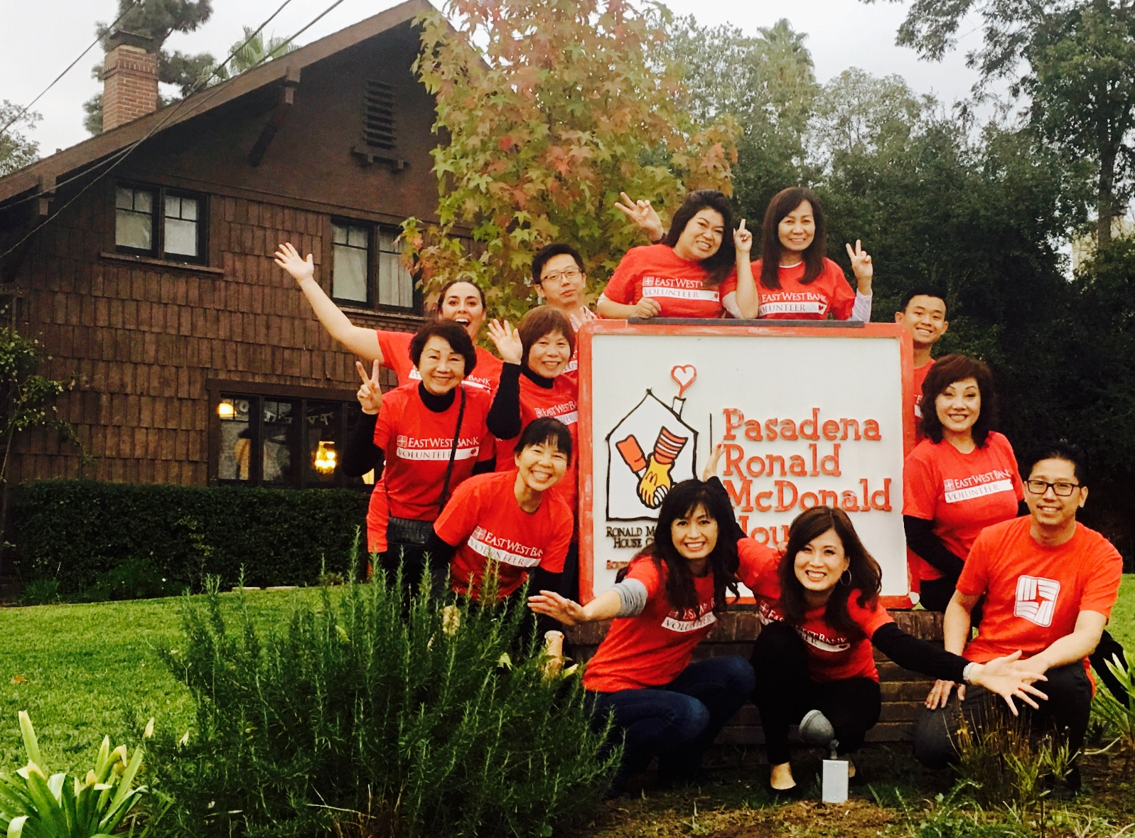 East West Bank employees smile optimistically outside Ronald McDonald House