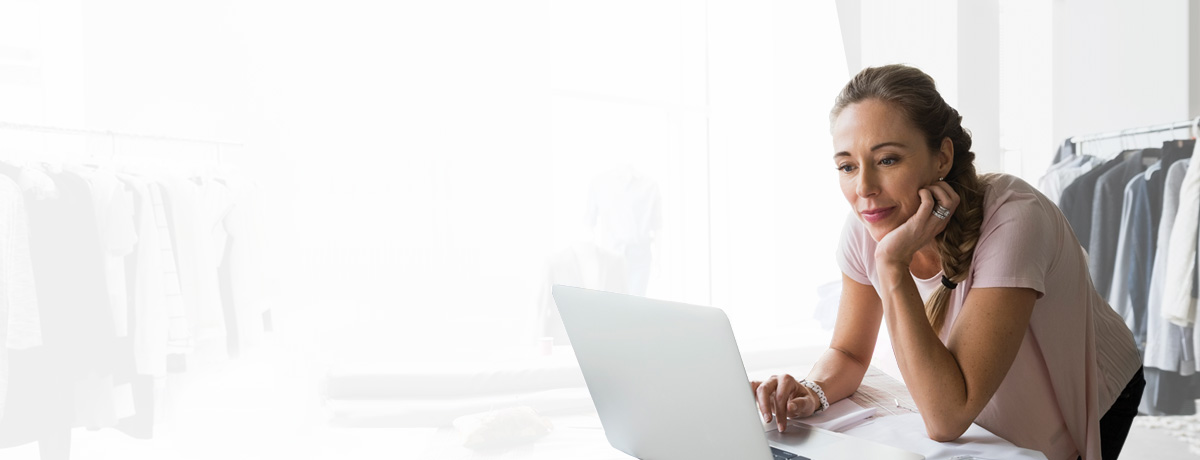 Woman business owner on computer.