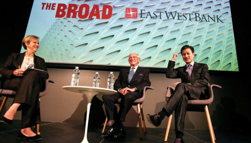 Dominic Ng speaking with Eli Broad in Los Angeles